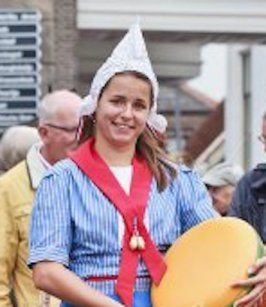 stock-photo-gouda-holland-august-traditional-dressed-dutch-girl-on-a-cheese-market-gouda-has-a-332307275